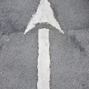 white painted arrow pointing upwards